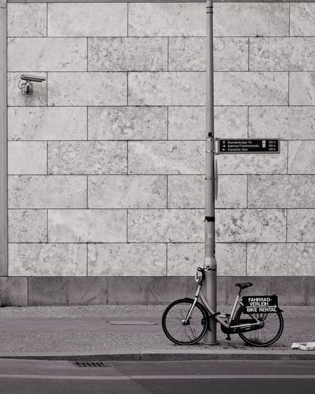 Bycicle Bicycle Wall - Building Feature Land Vehicle Transportation Architecture Building Exterior Built Structure Day Mode Of Transportation No People Text Communication City Outdoors Parking