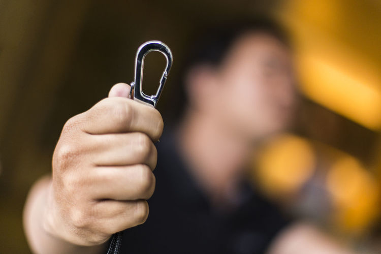 Close-up of man holding hook