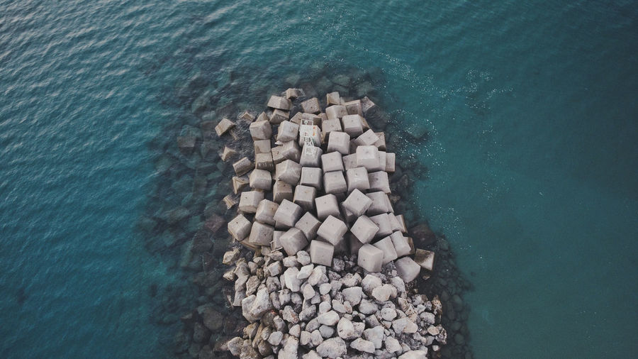 High angle view of pebbles by sea