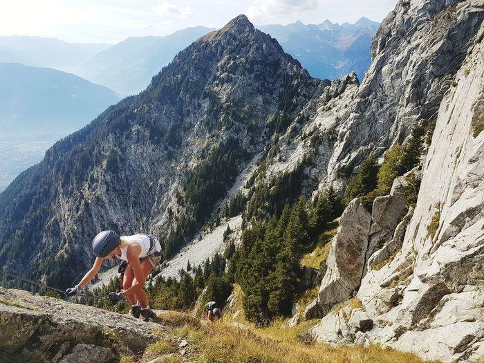Woman climbing mountains