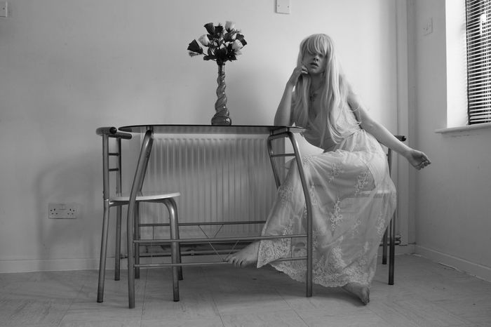 Embrace this Dress People Watching Vulnerable Young Youth Black And White Black And White Portrait Black And White Portraits Blackandwhite Day Flower Full Length Indoors  Mono Portrait One Person People Real People Vulnerability  Vulnerabilty Young Adult Young Woman Young Women Young Women Style Youthful