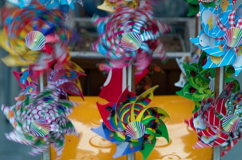 Pin Wheels Bright Colors Motion Blur Rainbow Colors Choice Collection Colorful For Sale Large Group Of Objects Motion Capture Multi Colored Pin Wheel Retail  Spin Spinning Around Toy Variation Windy
