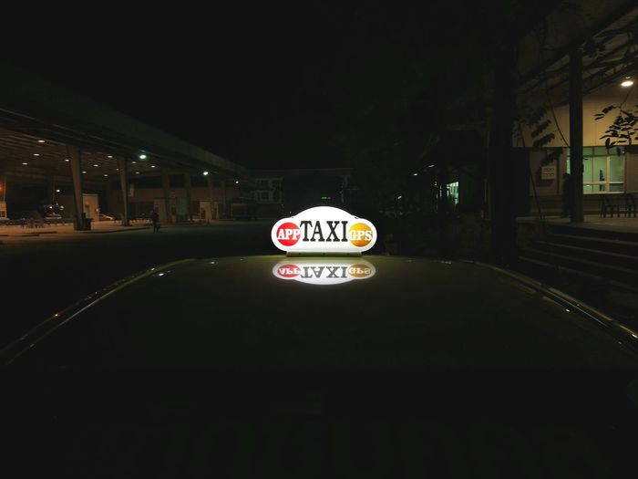 taxi to night Taxi No People Night Light City Parking Garage Road Sign Illuminated Ice Rink Communication Guidance Text Stop Sign Western Script