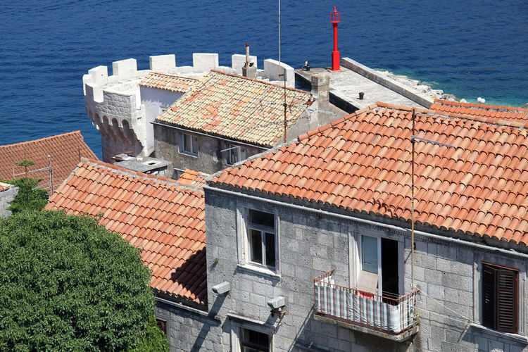 Architecture Building Exterior Built Structure Water Roof High Angle View Sea Building No People Day Nature Roof Tile Residential District House Outdoors Nautical Vessel Sunlight City Window