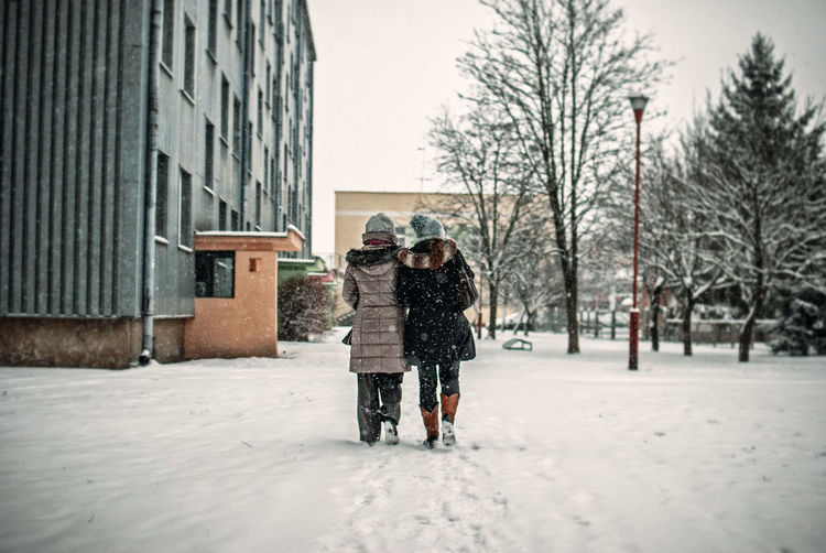 Adult Adults Only Bonding City Cold Temperature Day Friendship Full Length Light And Shadow Military Nikon Outdoors People Snow Snowing The Week Of Eyeem Togetherness Two People Warm Clothing Winter Winter Embrace Urban Life