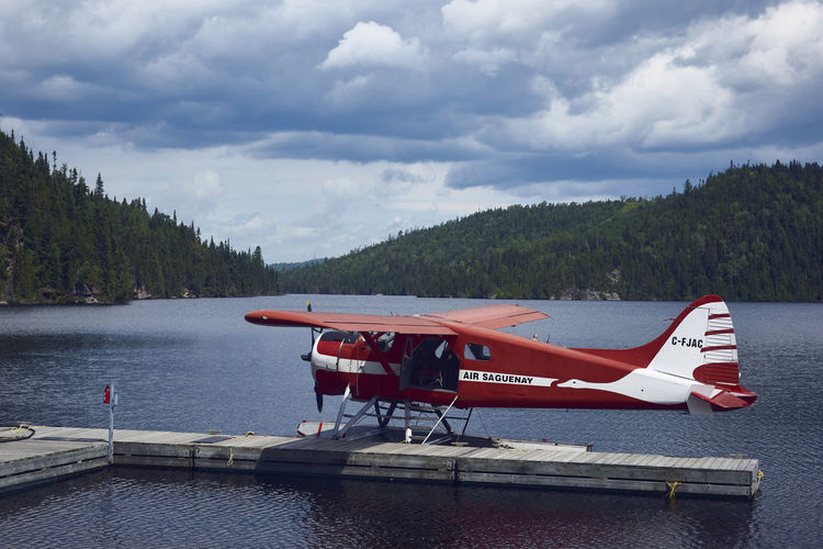 The Red Plane Hills Plane Quebec Red The Week On EyeEm Tree Blue Canada Cloud - Sky Forest Lake Sky Tourism Water