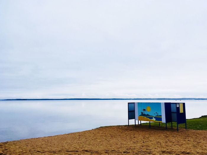 Water Beach Sand Nature Day Sky Cloud - Sky Sea Outdoors Lifeguard Hut Tranquility Built Structure Beauty In Nature Scenics Horizon Over Water No People
