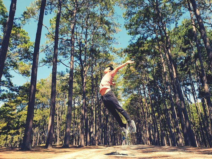 Man jumping in forest