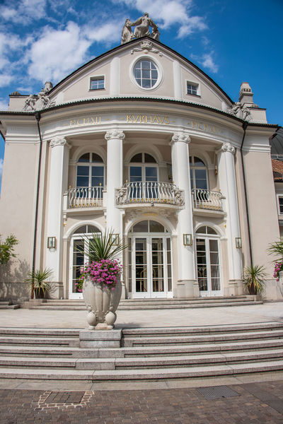Alto Adige Kurhaus Arch Architectural Column Architecture Building Building Exterior Built Structure Day Door Entrance Façade Flower Flower Arrangement Italy Merano Nature No People Outdoors Plant Potted Plant Sky South Tyrol Staircase Window