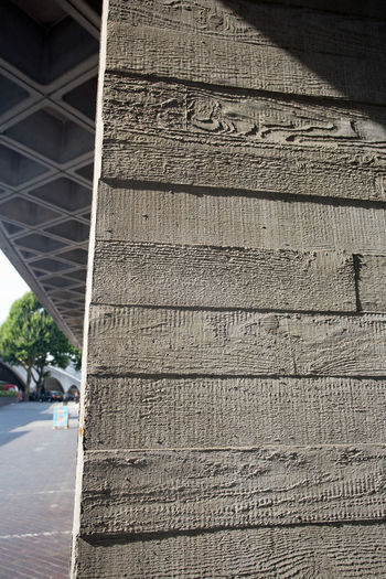 Concrete post made in sections showing wood grain. Construction London Wood Grain Architecture Boxes Building Exterior Built Structure Close-up Concrete Concrete, Famous Building, Day Grey How It Was Made No People Outdoors Sections Texture