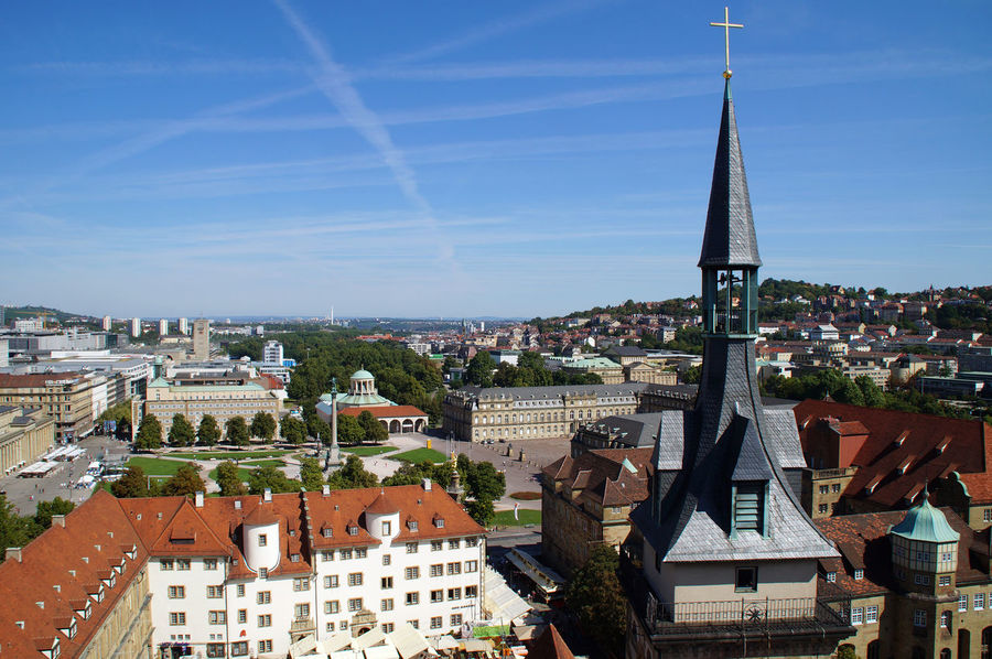 View from the west tower of the collegiate church in the South Tower and the underlying Schillerplatz, which is lined with the Old Firm. Right next to the south tower is the Old Palace, a former moated castle, which was built the Royal Palace later. Behind the castle is the new castle that the Schlossplatz - opens the gardens towards. Central to the park is the Victory Column. Links from the site covers the Königstrasse, Germany's longest pedestrian. The King Street leads on Königsbau over to Marquardbau from Stuttgart Central Station. The station tower is one of the landmarks of the city. Bell Tower Castle Christmas Cross Landescape New Castle Old Castle Schiller Sign Stuttgart Tourism Tourist Attraction  Tourist Destination Touristic