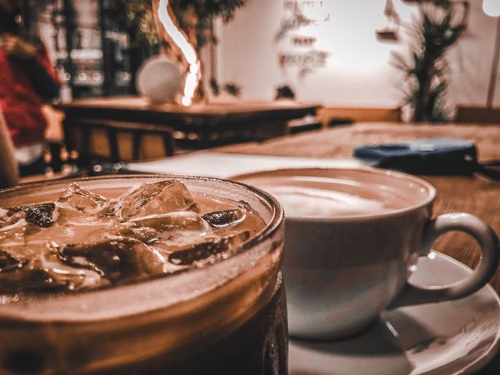 Ice or hot Latte 🤔 IPhoneography Lightroom Food And Drink Refreshment Drink Cup Coffee Coffee - Drink Table Close-up Coffee Cup Still Life Glass No People Focus On Foreground Drinking Glass Household Equipment Crockery Glass - Material Selective Focus Freshness