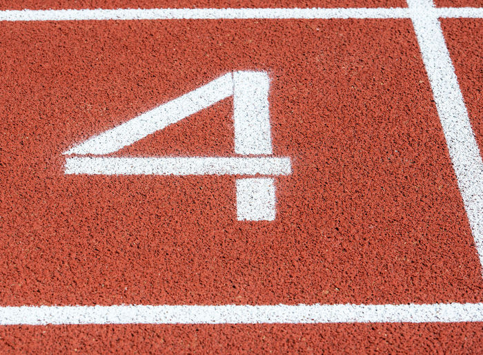 High angle view of number 4 on running track