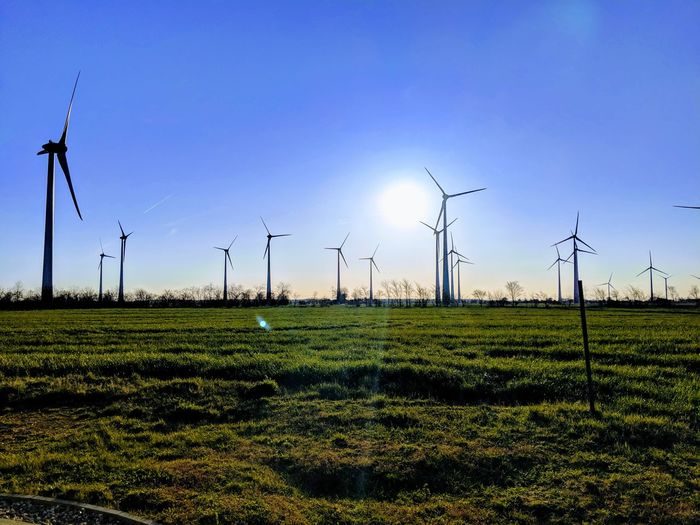 windfarm sunset Wind Turbine Wind Power Technology Electricity Pylon Manufacturing Equipment Alternative Energy Electricity  Turbine Fuel And Power Generation Cable Windmill Industrial Windmill Renewable Energy Cultivated Land Agricultural Field Farmland Environmental Conservation Electrical Grid