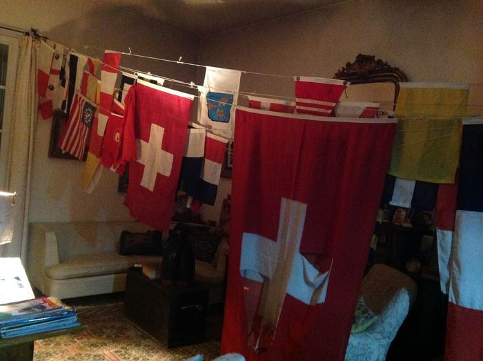 A collection of so many flags suggests a lifetime spent at sea sailing, in this case. Clothesline Flags From All Countries Visited By A Boat Flown At Precise Location When In That Country Hanging In A Row Indoors  No People Put Up For Celebratios