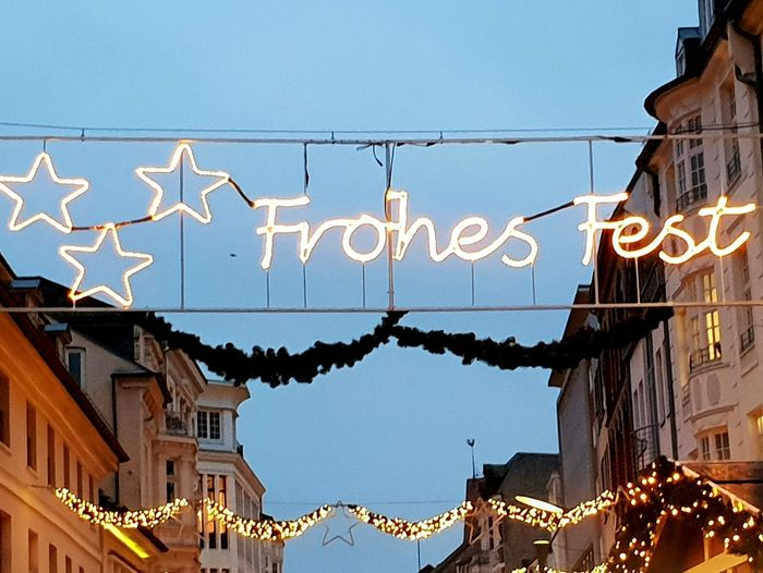 """""""FROHES FEST"""" street lights. ... City Clear Sky Business Finance And Industry Sky Architecture Decoration Street Art Christmas Ornament Christmas Decoration Christmas Lights"""