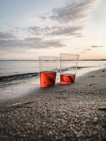 Sea Beach Water Sky Land Nature Cloud - Sky Tranquility Food And Drink No People Scenics - Nature Beauty In Nature Horizon Over Water Refreshment Sand Horizon Glass Outdoors Day Sunset