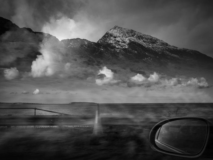 In camera double exposure, from the passenger seat of a moving car. Black & White Double Exposure Beauty In Nature Blackandwhite Photography Cloud - Sky Day Doubleexposure Landscape Mountain Nature No People Outdoors Road Trip Scenics Sea Seascape Sky Water