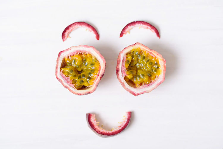 Fresh passion fruit and juice, healthy drink Concept Creative Diet Eating Exotic Face Food Fresh Freshness Fruit Funny Half Health Healthy Ingredient Juicy Natural Nutrition Organic Passion Ripe Seed Smile Tropical White Still Life Indoors  Studio Shot Wellbeing White Background Healthy Eating Close-up Passion Fruit Cross Section Food And Drink
