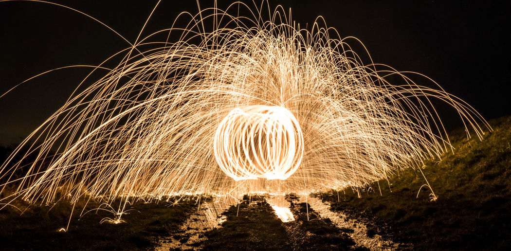 Wire wool against sky at night