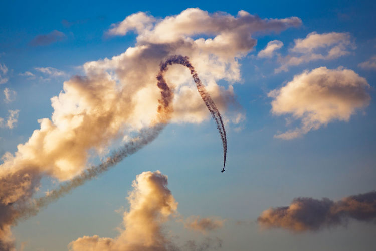 Aerobatics Air Vehicle Airplane Airshow Cloud - Sky Day Flying Low Angle View Mode Of Transportation Motion Nature No People on the move Outdoors Performance Plane Sky Smoke - Physical Structure Speed Transportation Vapor Trail