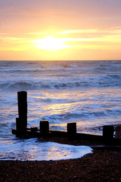 Cloud - Sky Sea Water Sky Sunset Beauty In Nature Horizon Scenics - Nature Horizon Over Water Beach Tranquility Tranquil Scene Nature Land Orange Color Wave Post No People Idyllic Sun Outdoors Wooden Post Brighton