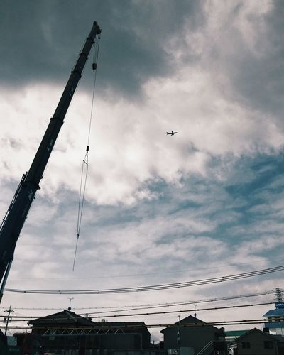 Jet Engine Airplane Plane Sky Cloud - Sky Low Angle View Flying Built Structure Outdoors Architecture No People Building Exterior Cable Day Technology Modern Workplace Culture Go Higher