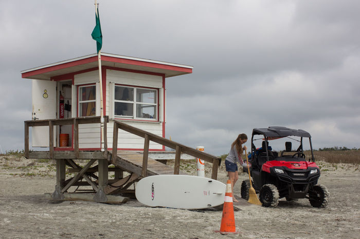 Sweeping the ramp Beach Life Beach Photography Four Wheeler Jetty Park Life Guard Life Guard Stand Life Guard Station Surfboard Sweeping Sweeping The Floor Young Woman