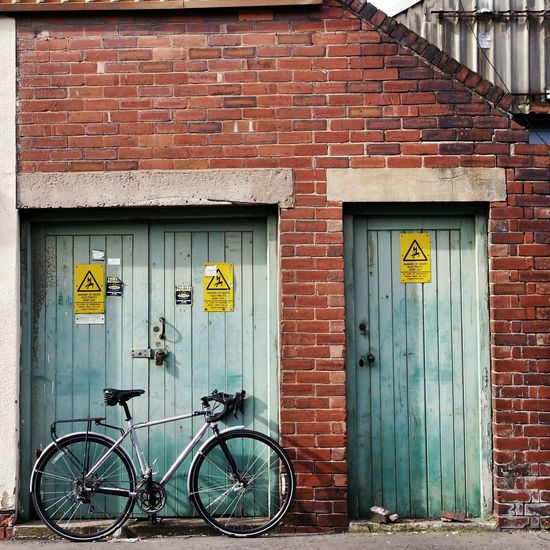 Bicycle parked outside building
