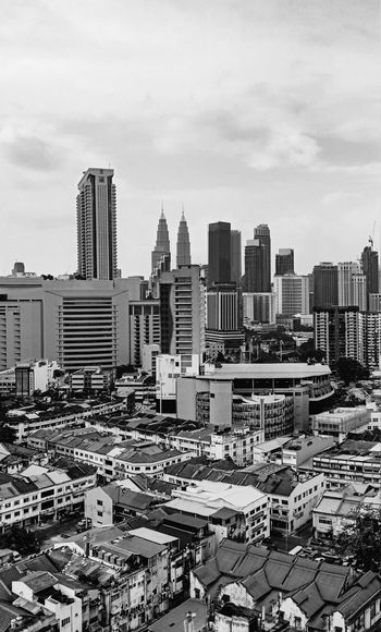 Urbanisation Petronas Twin Towers Kuala Lumpur Urbanisation Poor And Rich Blackandwhite Bnw Blackandwhite Photography Silhouette_collection City Cityscape Urban Skyline Modern Skyscraper Downtown District City Life Sky Architecture Building Exterior Construction Tall - High Housing Settlement Settlement Office Building