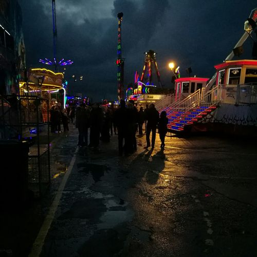 A storm developed very quickly during this year's Hull Fair. No filter needed here as the natural light contrasts against the fair lights. Fairgrounds Silhouettes Hull Fair Fairground Ride Fairgrounds Stormy Weather Storm Clouds