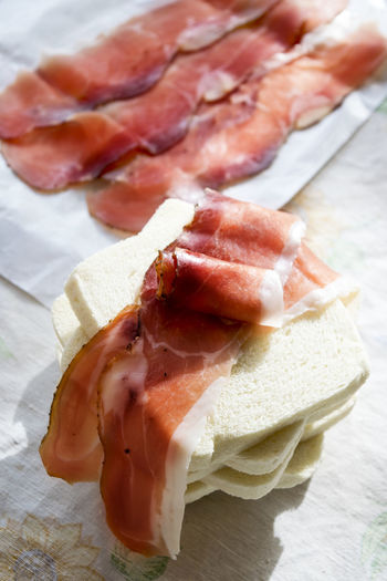 light meal consisting in a sandwich with italian speck or salted smoked ham Bread Filling Italian Light Meal Lunch Pause Salted Smoked Ham Sandwich Snack Speck Tramezzino