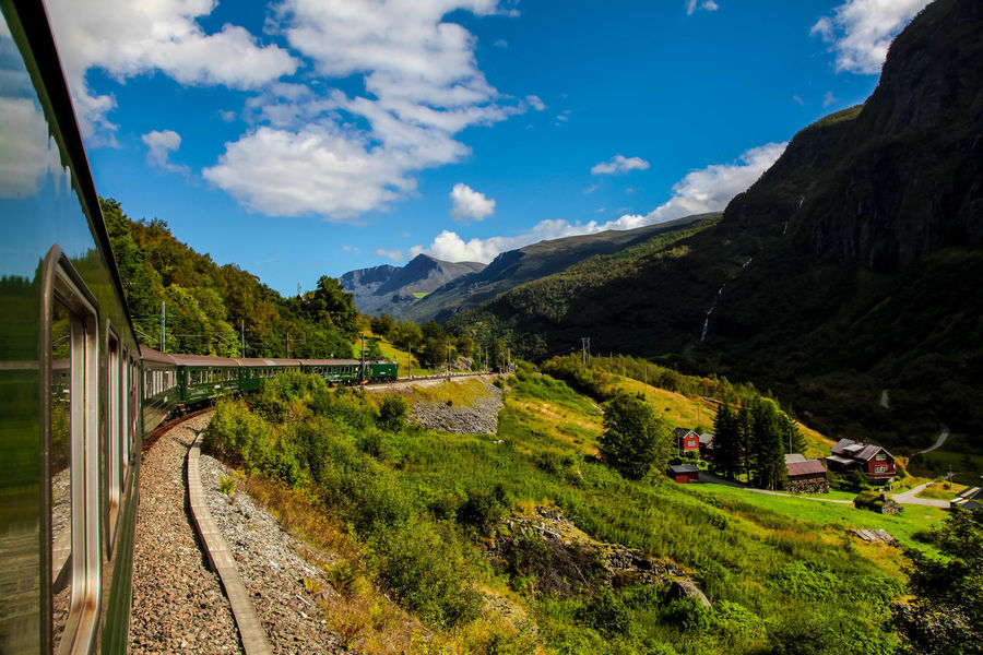 Scenic railway to the town Flom Flåm Flamsbana Flåmsbanen Norway Norway🇳🇴 Norway Nature Norway🇳🇴 DreamTrip Landscape Mountain Cloud - Sky Outdoors Scenics Sky No People Nature Beauty In Nature Mobility In Mega Cities