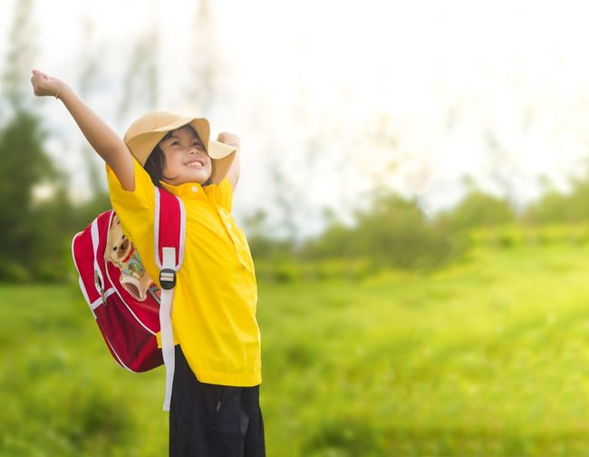 Happy holiday Yellow One Person Happiness Women Leisure Activity Clothing Lifestyles Smiling Human Arm Real People Focus On Foreground Standing Land Nature Females Day Field Front View Emotion Hat