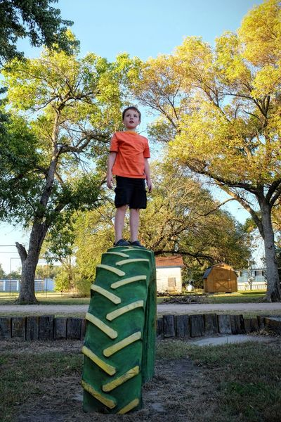 Photo essay - A day in the life. Strang, Nebraska October 2016 A Day In The Life America Autumn Boyhood EyeEm Best Shots EyeEm Masterclass Fall Colors Fall Leaves Full Length Green Color Growing Up Kids Being Kids Low Angle View Park - Man Made Space Photo Diary Photo Essay Photography Playground Portrait Small Town America Small Town Stories Standing Standing Tall Tire Visual Journal