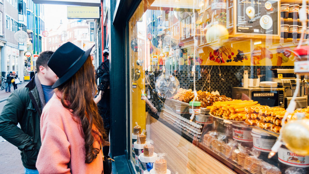 Tasty waffles in Amsterdam. Adult Alicia Scammell Amsterdam Amsterdamcity Bakery Business Finance And Industry Chocolate Churro Churros City City Life Day Food Food And Drink People Retail  Store Street Food Waffle Window Shopping
