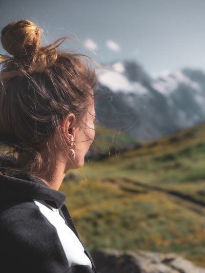 Side view of woman looking at mountains