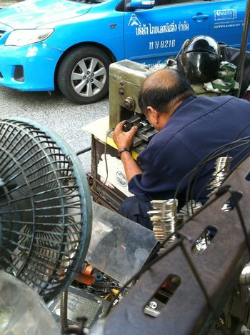 a vendor of traditional locksmith on the sidewalk at Silom Road Bangkok Adult Adults Only Day Expertise Keys Locksmith Low Tech Machinery Manual Worker Men Occupation One Man Only One Person Only Men Outdoors People Rear View Skill  Technician Working Workshop