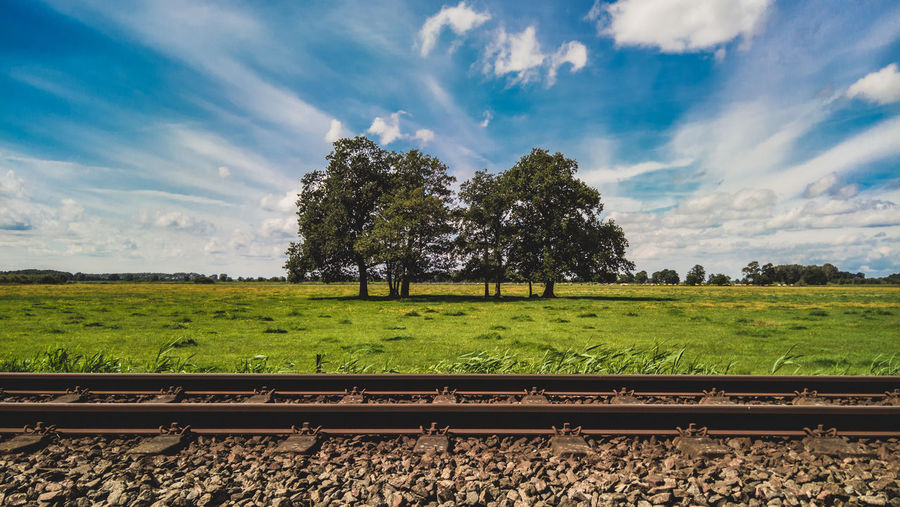 Sky Landscape No People Tree Beauty In Nature Day Nature Tranquility Grass Field Tranquil Scene Cloud - Sky Railroad Track Outdoors Green Color Scenics