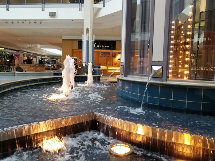 Water Full Length Spraying Illuminated Pennsylvania Westmoreland Mall Water Fountain Water Splash Waterfall Indoors  Elevator Water Reflection Lights Shopping Mall Retail Shopping Businesses
