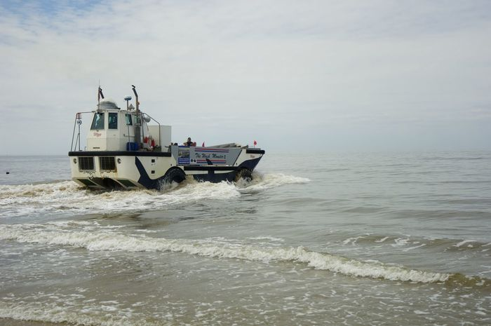 An Amphibious vehicle takes day trippers out to sea. Amphibious Vehicle Hunstanton Beach Pleasure Boat Sea Uk Coastline Water Waterfront Waves