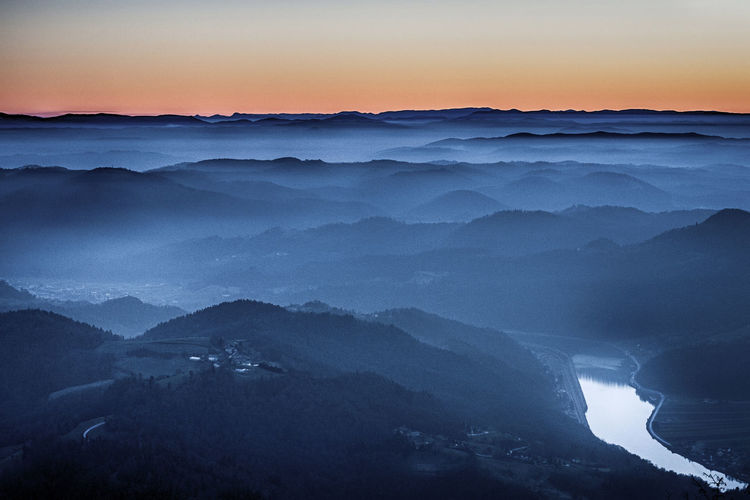 Blue Hour Beauty In Nature Blue Environment Fog Hazy  Idyllic Landscape Majestic Mountain Mountain Peak Mountain Range Nature No People Non-urban Scene Outdoors Remote River Scenics - Nature Sky Sunset Tranquil Scene Tranquility Water HUAWEI Photo Award: After Dark It's About The Journey