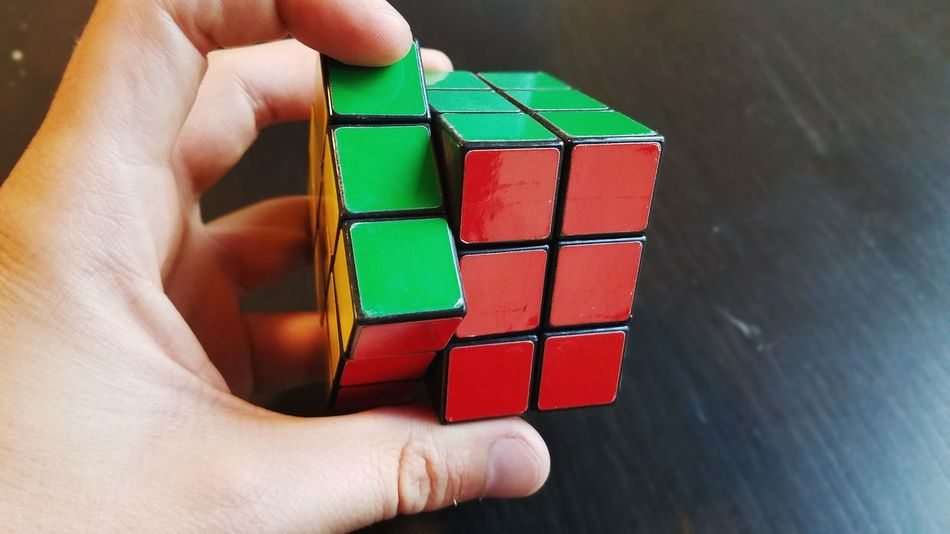 Rubik's Cube Puzzle Game Brain Game Brain Teasrer Smart Intelligence Spacial Intelligence EyeEm Selects Human Hand Holding Men Toy Block Arts Culture And Entertainment Close-up