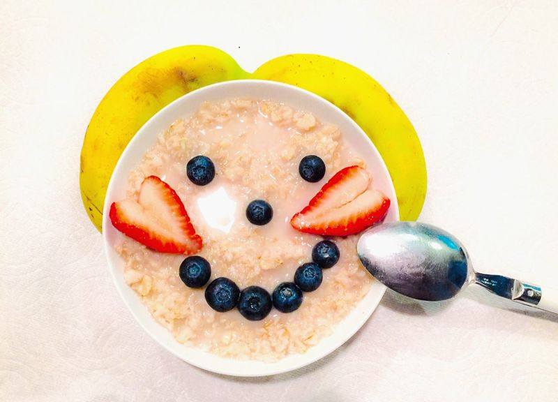 My fun little food design Breakfast Oatmeal Fruits Strawberry Heart Shape Blueberry Bowl Spoon Food Oats Meal Home Is Where The Art Is Colour Of Life Eyeemphoto Two Is Better Than One Two Hearts Two Bananas Two Eyes