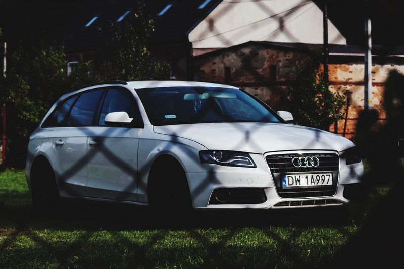 Audi A4 Cars A4 Audi Audience Mode Of Transportation Motor Vehicle Car Land Vehicle Transportation No People Day Nature Architecture Outdoors Built Structure Text Parking Plant Building Exterior Stationary Sunlight City White Color