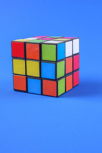 RUBIK'S CUBE , CREATIVITY TOY Creativity Rubik Cube Block Block Shape Blue Blue Background Close-up Colored Background Copy Space Cube Shape Cut Out Design Geometric Shape Indoors  Intelligence Multi Colored No People Rubik Shape Still Life Studio Shot Toy Toy Block Wood - Material