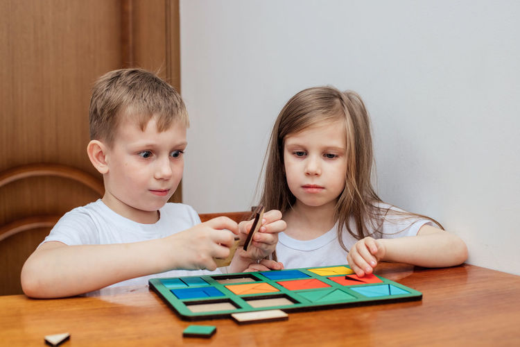 Cute kids playing toy at home
