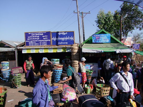 Baggage Carrier Station at Mount Kyaiktiyo (Golden Rock) Baggage Carriers Baskets Blue Sky Buddhism Buddhist Culture Composition Full Frame Kinpun Making A Living Mount Kyaiktiyo Mount Kyaiktiyo Pagoda Myanmar Outdoor Photography People Sunlight And Shadows Travel Destination Workers