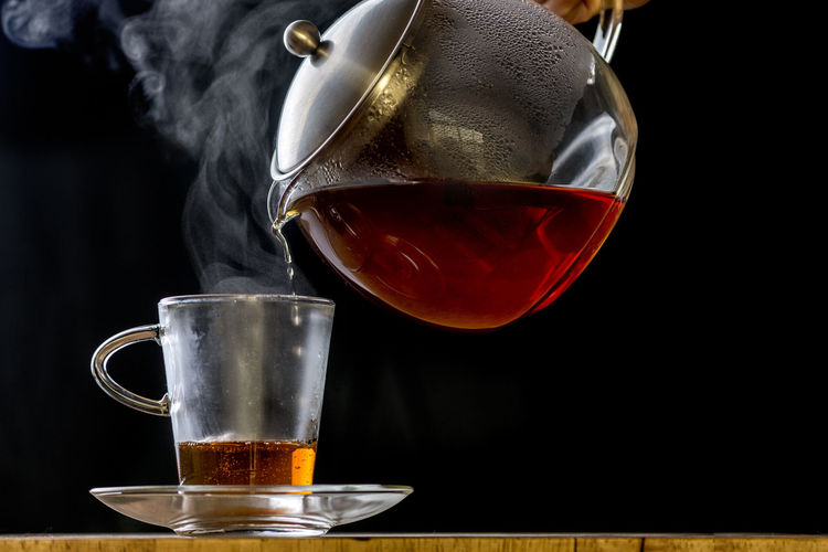 glass tea pot pouring a cup of tea Tea Black Background Close-up Coffee Cup Drink Drinking Glass Food Food And Drink Freshness Glass Glass Cup Glass Tea Pot Brewing Tea Leaves Household Equipment Indoors  Mug Pour Refreshment Still Life Table Tea - Hot Drink Tea Pot Tea Time