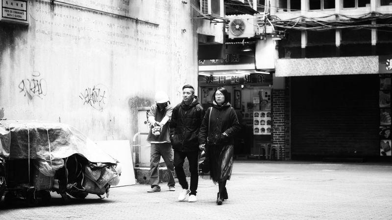 Walking Macau Trip Blackandwhite EyeEm Best Shots - Black + White Black & White Cityscape Streetphotography Macau, China Full Length Men Street Building Exterior Built Structure Stories From The City